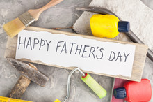 Handwritten Inscription Happy Fathers Day On Torn White Paper Near Scattered Tools On Old Gray Concrete