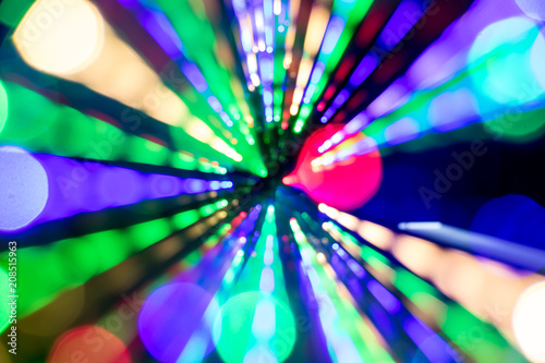 Fotografia, Obraz  Diagonal blurred lines of color lights is converged on dark background