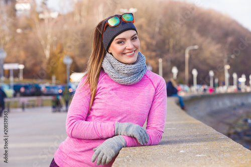 Deurstickers Ontspanning Woman resting after doing sports outdoors on cold day