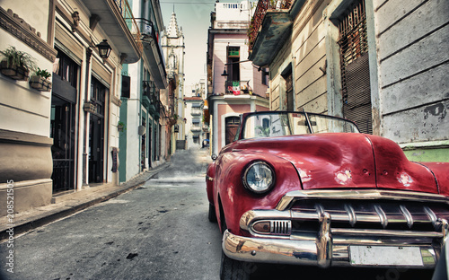 Old american car parked in a street of Havana Canvas Print