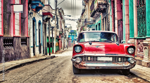 Garden Poster Havana Old red Chevrolet car parked in a street of havana