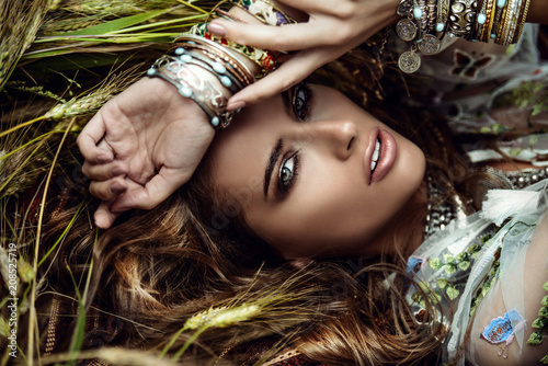 Foto auf Gartenposter Gypsy girl lying in grass