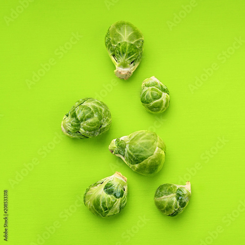 Foto op Canvas Brussel Food background flat lay, brussels sprouts on green background, top view.