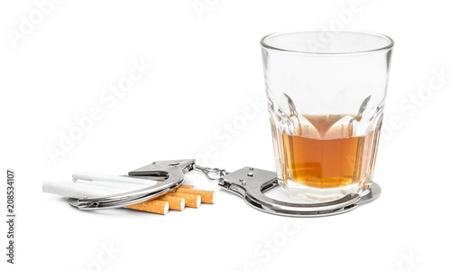 Poster Bar Glass of alcohol drink and cigarettes with handcuffs on white. Bad habits concept.