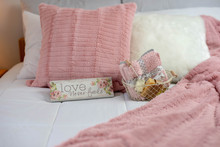 Cozy Neutral Decor Guest Bedroom With Pink Accents