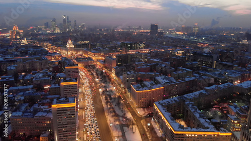 Fototapeta Aerial shooting of Moscow Garden Ring in the evening. City lights in the dusk. Business center
