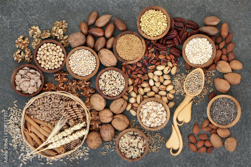 Food with high fibre content for a healthy diet with whole wheat bread, whole grain pasta, nuts, seeds, legumes, grains and cereals. High in antioxidants, anthocyanins, vitamins & omega 3 fatty acids.