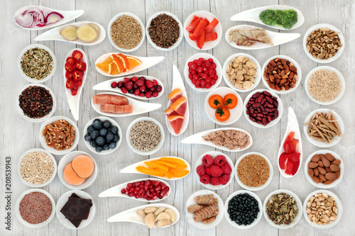 In de dag Assortiment Health food for a healthy heart with fish, vegetables, fruit, nuts, seeds, pulses, spice & medicinal herbs. Super food concept. High in omega 3 fatty acid, smart carbs, antioxidants & minerals.