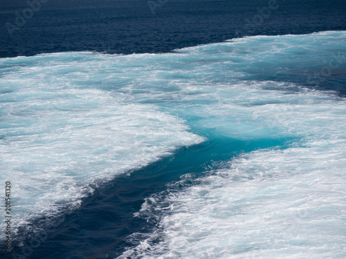 Close up of  the sea that is foaming due to the ship's engine Canvas Print