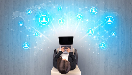 Obraz Social media concept with woman sitting on chair with tablet on her hand