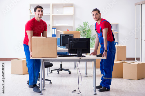 Two contractor employees moving personal belongings Canvas Print
