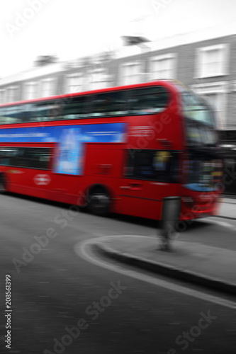 Papiers peints Londres bus rouge Iconic London red double decker bus, abstract with motion blur and selective color