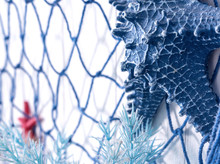 Blue Net And Artificial Starfish Made Of Plastic On The Wall