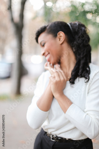 Fotografie, Obraz  Beautiful black pretty female person wearing business clothes and having pony tail hair do