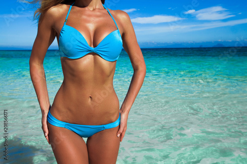 Obraz Tanned woman body in bikini - fototapety do salonu