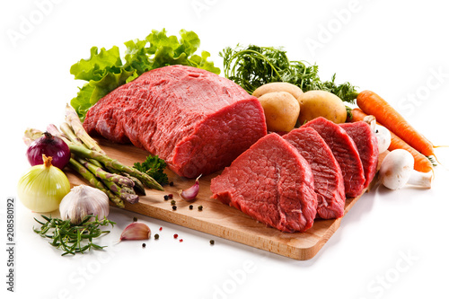 Staande foto Vlees Raw beef on cutting board on white background