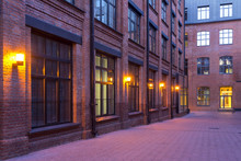 Night View. Industrial Building. Modern Loft-style Offices Located In The Old Factory Building. Red Brick Houses. Vintage. Buildings With Large Windows. Vintage