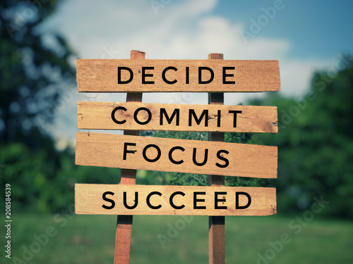 Motivational and inspirational quote - 'Decide, commit, focus, succeed' written on plank signage Canvas-taulu