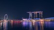 Singapore, Beautiful Time lapse of Singapore night skyline with dramatic laser and light show. 4K. Motion Timelapse Panning Right