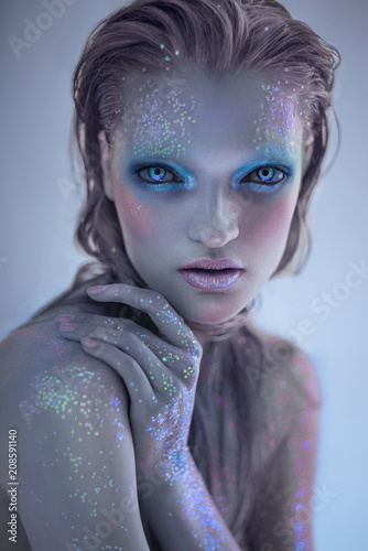 Fényképezés Portrait of alien woman with glitter make up looking at camera
