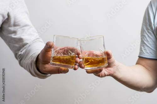 Poster Bar Two men clanging glasses of alcoholic beverage together while