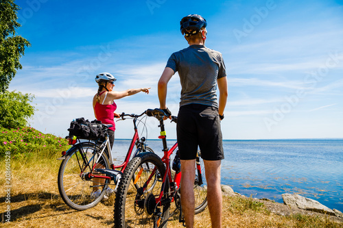 Healthy lifestyle - people resting with bicycles