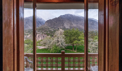 Door opened looking outside beautiful view in summer at Northern Pakistan