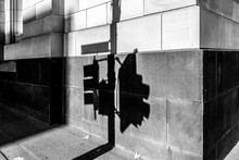 Shadow Of Traffic Light On A Wall On Street Corner In Black And White. Melbourne, Australia