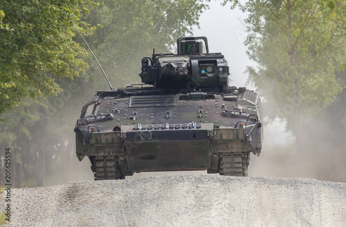 German infantry fighting vehicle drives on a street Canvas Print