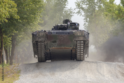 German infantry fighting vehicle drives on a street Canvas-taulu