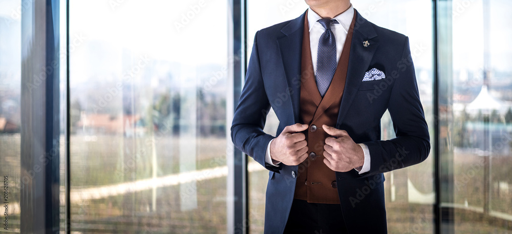 Fototapeta Man in custom tailored suit posing indoors