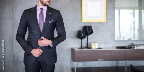 Fotografiet Man in custom tailored business suit posing indoors