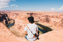 Young Man With Magnificent View Of Horseshoe Bend, Grand Canyon, Arizona, USA.