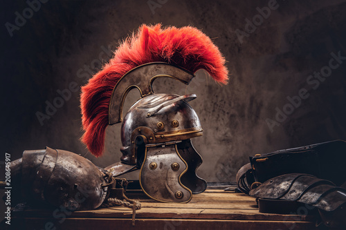 Complete combat equipment of the ancient Greek warrior lie on a box of wooden boards Slika na platnu