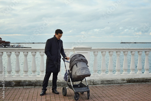 man with stroller Canvas Print