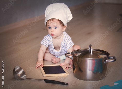 aa142f6b48a Little child boy in chef hat on a floor with pot and ladle - Buy ...