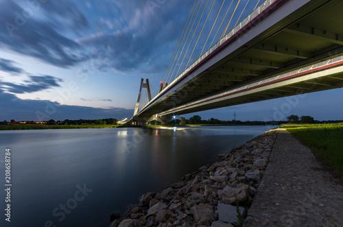 Staande foto Brug modern bridge over Vistula river, Krakow, Poland, illuminated in the night