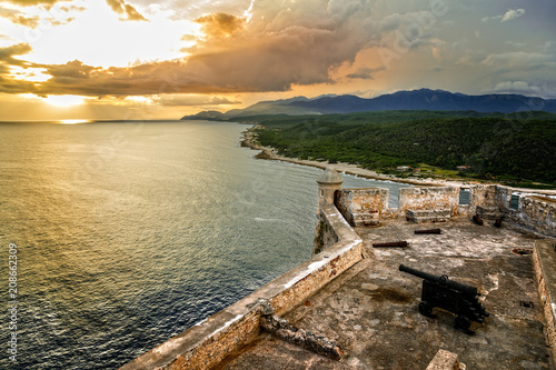 Recess Fitting Fortification San Pedro de La Roca fort walls with canon, Carribean sea sunset view, Santiago De Cuba, Cuba