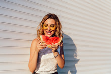 Pretty Girl Eating A Watermelon, Wearing Yellow Sunglasses, Enjoying The Summer Days, Outdoors.