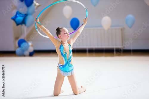 Foto op Aluminium Gymnastiek Adorable girl competing in rhythmic gymnastics
