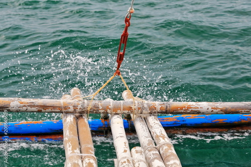 Bamboo outrigger projecting from a Filipino bangka boat-N.Bays Bay-Negros Oriental-Philippines.0527