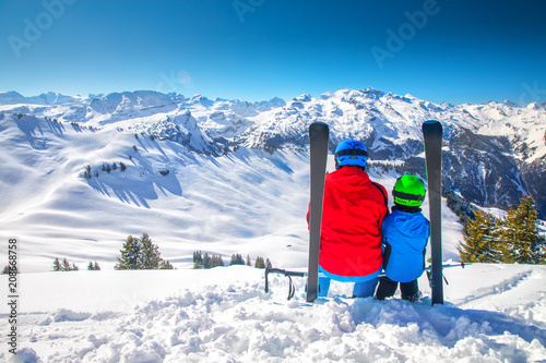 Father with his son skiing and enjoying the view of Swiss Alps, Hoch Ybrig, Switzerland, Europe