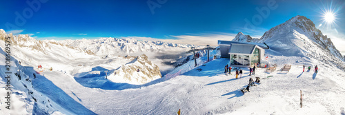 Stunning winter panorama in Tonale ski resort. View of Italian Alps from Adamelo Glacier, Italia, Europe
