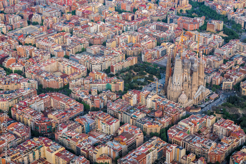 Barcelona aerial view of Eixample residencial district and Sagrada Familia, Spain