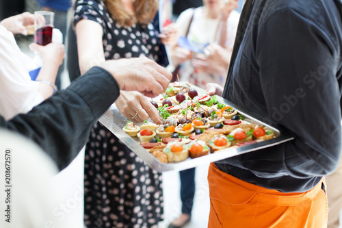 Fototapeta waiter doing catering service at social gathering obraz