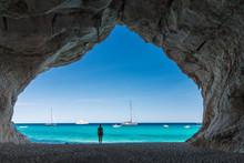 Woman Inside A Cave At Cala Luna Beach
