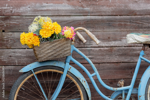 Vintage blue bike on wood background