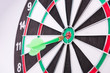 On the Target. Green dart hitting the target.