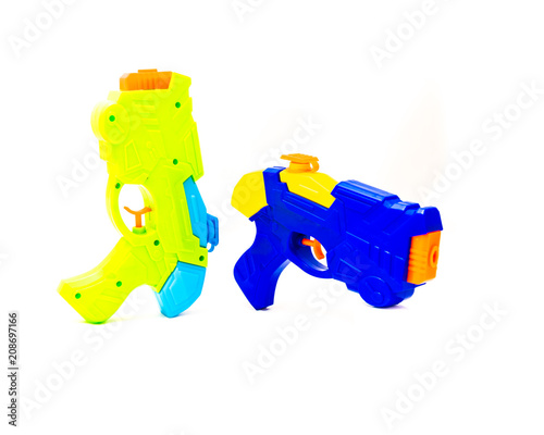 Close-up top view two water guns swimming pool beach toy isolated on white background. Studio shot durable thick plastic water squirt blaster soaker summer, pool party gear for children