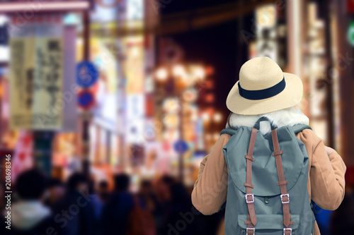 Photo sur Toile Hong-Kong Tourist is traveling at Shinsaibashi night street shopping district in Osaka, Japan.
